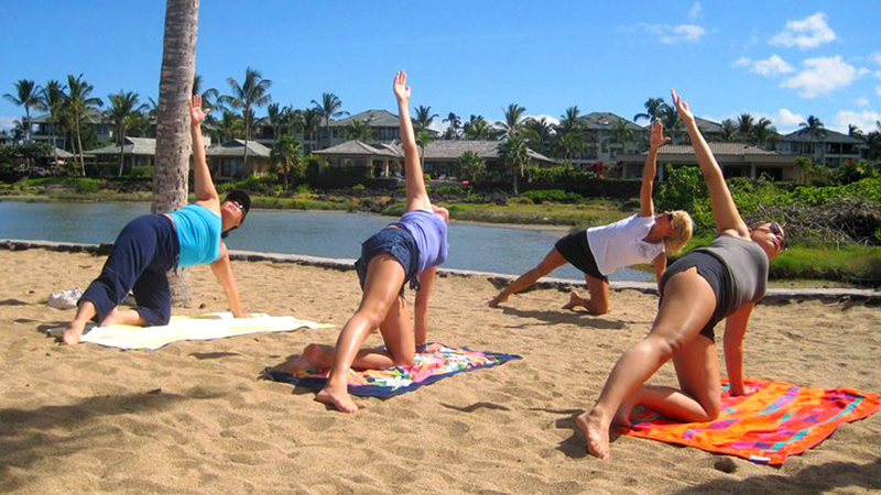 best things to do in waikoloa village morning yoga stretch at anaeho'omalu bay hawaii